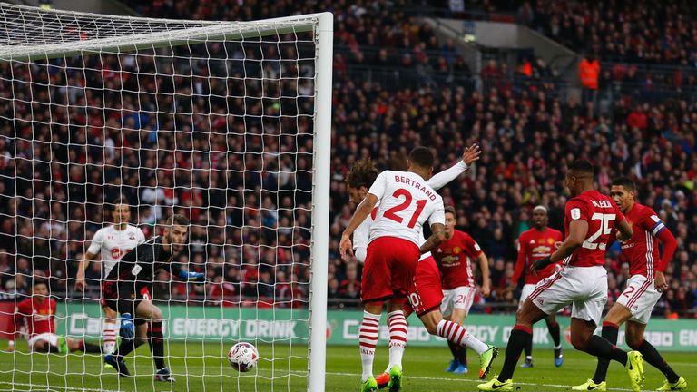 Southampton's Italian striker Manolo Gabbiadini (C) slots the ball past Manchester United's Spanish goalkeeper David de Gea but the goal is disallowed for