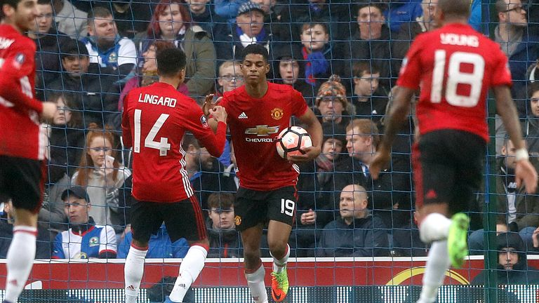 Manchester United's Marcus Rashford celebrates scoring his side's first goal of the game during the Emirates FA Cup, Fifth Round match at Ewood Park, Black
