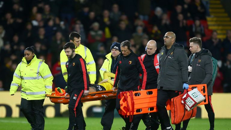 WATFORD, ENGLAND - FEBRUARY 25:  An injured Mauro Zarate of Watford is stretchered off during the Premier League match between Watford and West Ham United