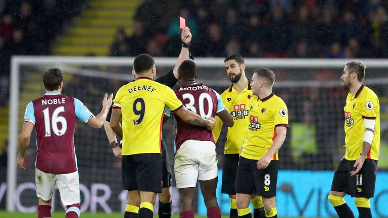 WATFORD, ENGLAND - FEBRUARY 25: Michail Antonio of West Ham United is shown a red card during the Premier League match between Watford and West Ham United