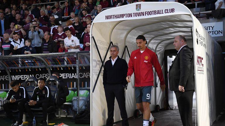 NORTHAMPTON, ENGLAND - SEPTEMBER 21: Jose Mourinho, Manager of Manchester United and Zlatan Ibrahimovic of Manchester United make their way out of the tunn