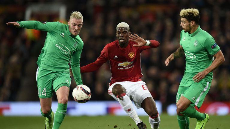 Manchester United's French midfielder Paul Pogba (C) vies with Saint-Etienne's French midfielder Jordan Veretout (L)