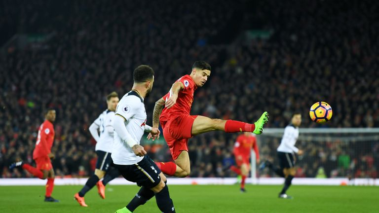 Philippe Coutinho in action as Liverpool take on Tottenham