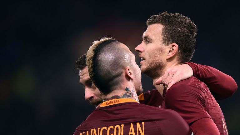 Roma's forward Edin Dzeko (right) is congratulated after scoring against Chievo