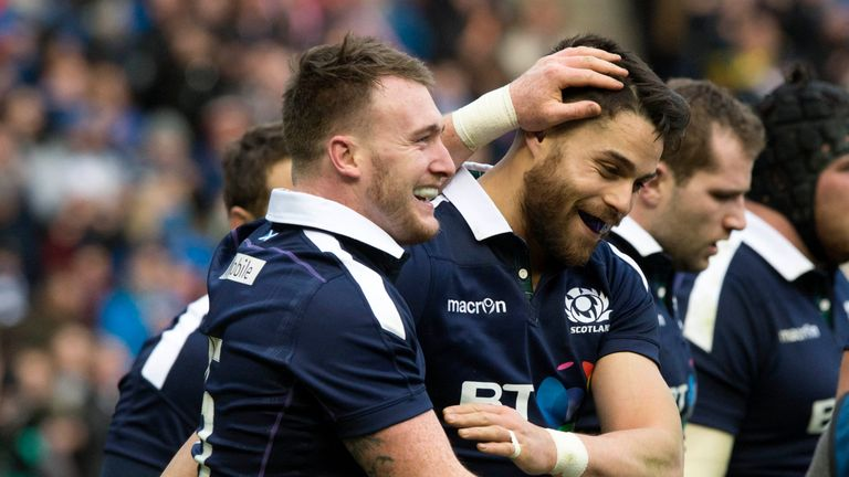 Stuart Hogg (left) celebrates his second try against Ireland with Sean Maitland