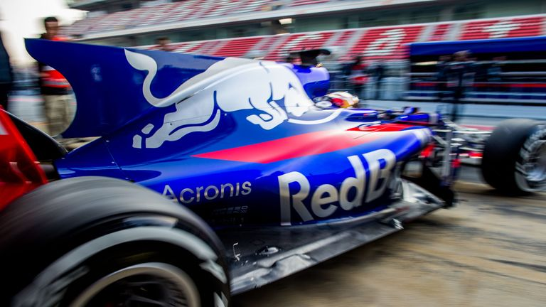 The shark fin-shaped engine cover on the striking Toro Rosso