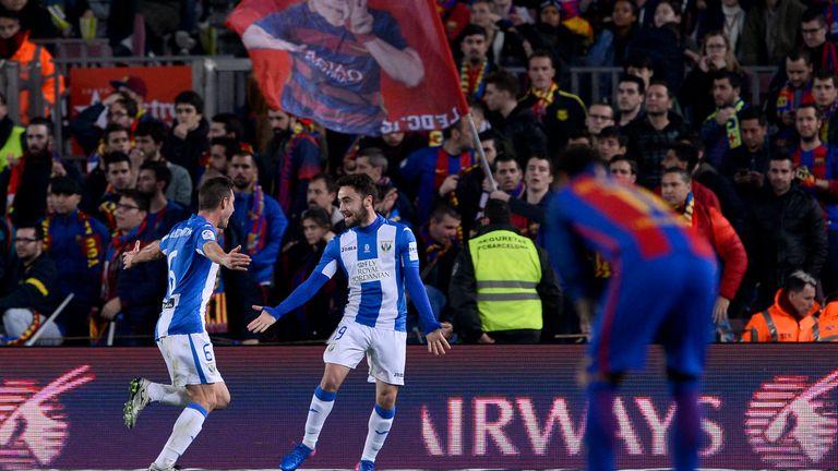 Lopez (R) celebrates his goal with Alberto Martin