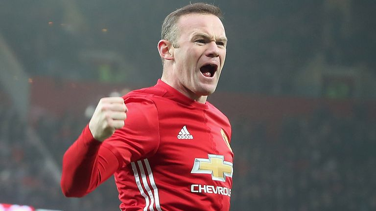 Wayne Rooney celebrates after scoring and equalling Sir Bobby Charlton's club goals record of 249 during the Emirates FA Cup Third Round against Reading