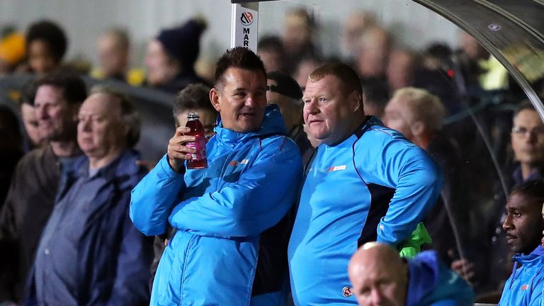 Wayne Shaw in conversation with Sutton United manager Paul Doswell during the FA Cup Fifth Round