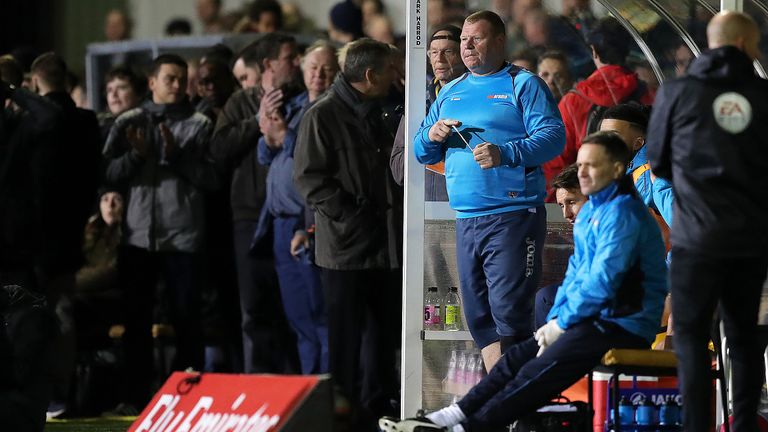 Wayne Shaw stands on the touchline during the FA Cup, Fifth Round match at Gander Green Lane