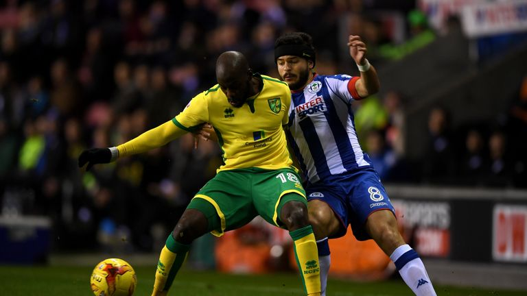 Norwich's Youssouf Mulumbu is tackled by Sam Morsy of Wigan