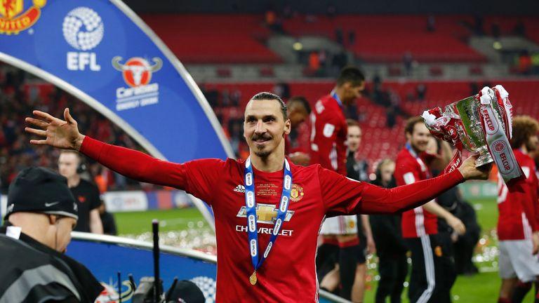 Zlatan Ibrahimovic celebrates with the EFL Cup