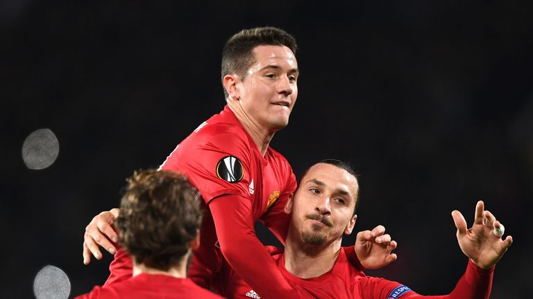 MANCHESTER, ENGLAND - FEBRUARY 16:  Zlatan Ibrahimovic of Manchester United celebrates scoring his sides first goal with Ander Herrera  during the UEFA Eur