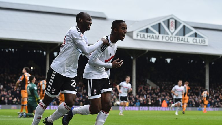 Fulham's Ryan Sessegnon (R) celebrates with Sone Aluko (L) after scoring during the English FA Cup fourth round win over Hull City