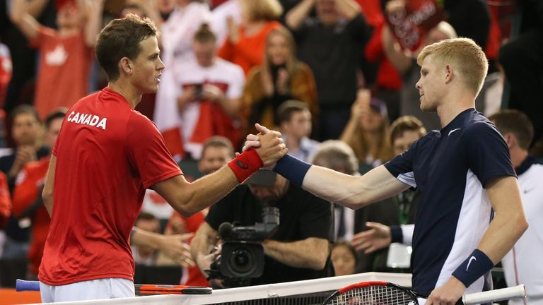 Vasek Pospisil shakes hands with Kyle Edmund of Great Britain after the Canadian won in straight sets to level the tie at 1-1