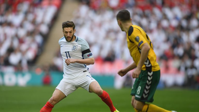 LONDON, ENGLAND - MARCH 26:  Adam Lallana of England takes on Egidijus Vaitkunas of Lithuania during the FIFA 2018 World Cup Qualifier between England and