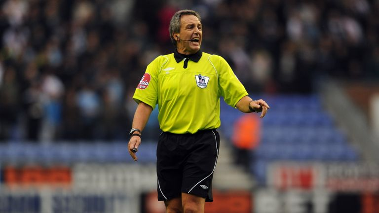 Referee Alan Wiley officiates during the English Premier League football match between Wigan Athletic and Manchster City at the DW Stadium in Wigan, north-