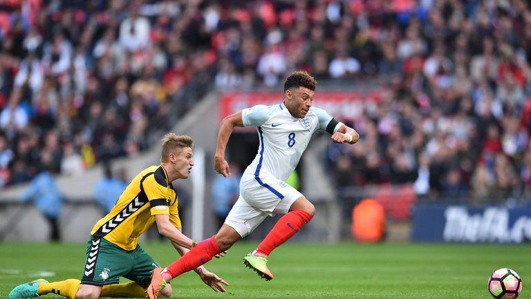 England's midfielder Alex Oxlade-Chamberlain (R) runs away from Lithuania's midfielder Vykintas Slivka during the World Cup 2018 qualification football mat