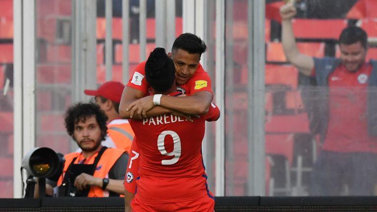 Chile's Esteban Paredes (bottom) celebrates with teammate forward Alexis Sanchez  after scoring against Venezuela during their 2018 FIFA World Cup qualifie