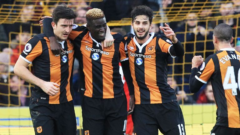 Alfred N'Diaye (2nd L) celebrates with team-mates after scoring the opening goal against Liverpool