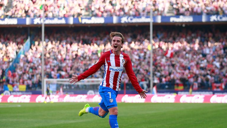 Antoine Griezmann celebrates after scoring a stunning free-kick against Sevilla