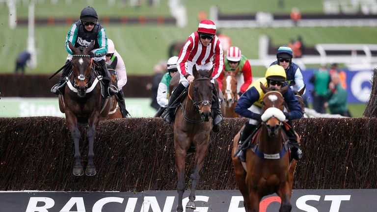 CHELTENHAM, ENGLAND - MARCH 14: Nico de Boinville ridng Altior (L) on their way to winning The Racing Post Arkle Challenge Trophy Novices Steeple Chase at