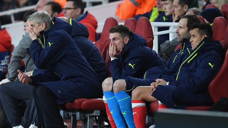 LONDON, ENGLAND - MARCH 07:  (L-R) Arsene Wenger, Manager of Arsenal, Aaron Ramsey, Petr Cech and Alexis Sanchez of Arsenal look dejected on the bench duri
