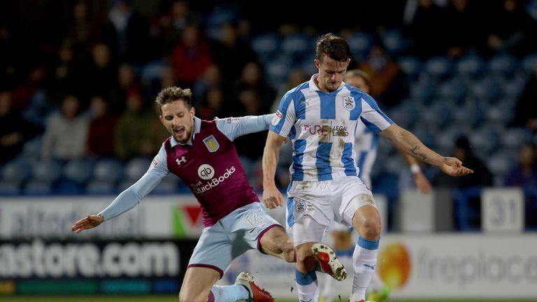 Aston Villa's James Bree (left) tackles Huddersfield Town's Jonathan Hogg during the Sky Bet Championship match at the John Smith's Stadium, Huddersfield.