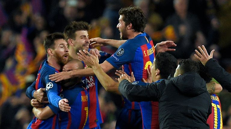 Barcelona players celebrate their victory during the UEFA Champions League round of 16 second leg football match vs Paris Saint-Germain FC