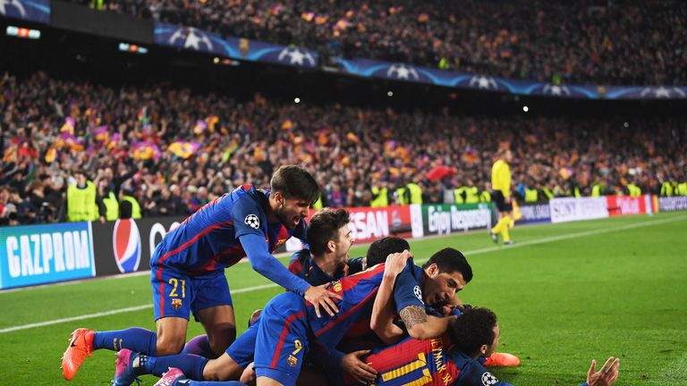 Luis Suarez and Neymar celebrate Sergi Roberto's dramatic goal against PSG
