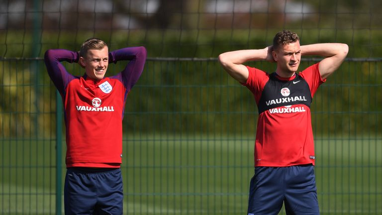 ENFIELD, ENGLAND - MARCH 25:  (L-R) James Ward-Prowse and Ben Gibson of England run through drills during the England training session at the Tottenham Hot