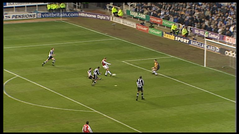 Bergkamp slots the ball past Newcastle 'keeper Shay Given