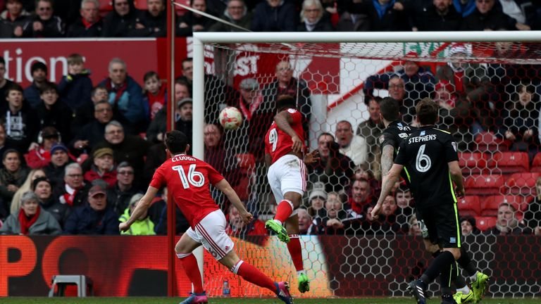 Nottingham Forest's Britt Assombalonga (centre) scores his side's first goal of the game during the Sky Bet Championship match at the City Ground, Nottingh