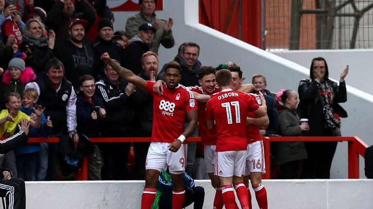 Britt Assombalonga (left) celebrates Nottingham Forest's first goal during the Championship match v Brighton at the City Ground, scored by Zach Clough