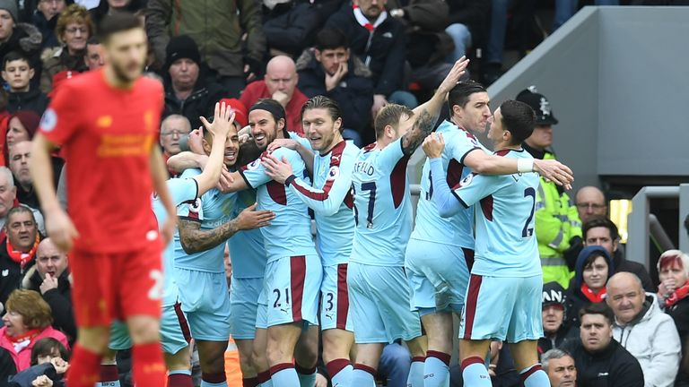 Burnley's English striker Ashley Barnes celebrates with team-mates after scoring the opening goal at Anfield