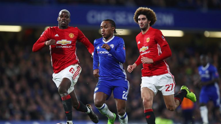 LONDON, ENGLAND - MARCH 13:  Willian of Chelsea is chased by Paul Pogba and Marouane Fellaini of Manchester United during The Emirates FA Cup Quarter-Final