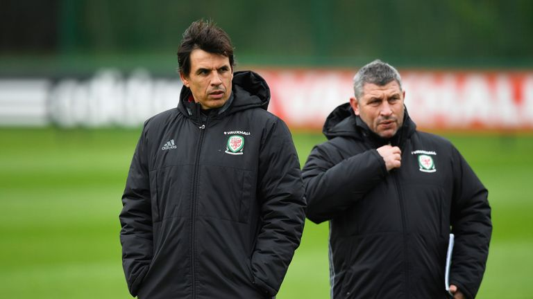 Wales manager Chris Coleman and Osian Roberts (R) look on during an open training session