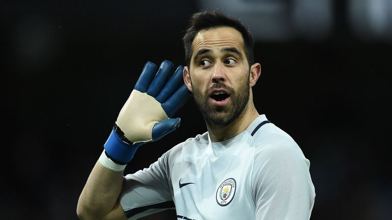 Manchester City's Chilean goalkeeper Claudio Bravo gestures to the Huddersfield fans after Manchester City's Nigerian striker Kelechi Iheanacho scored his