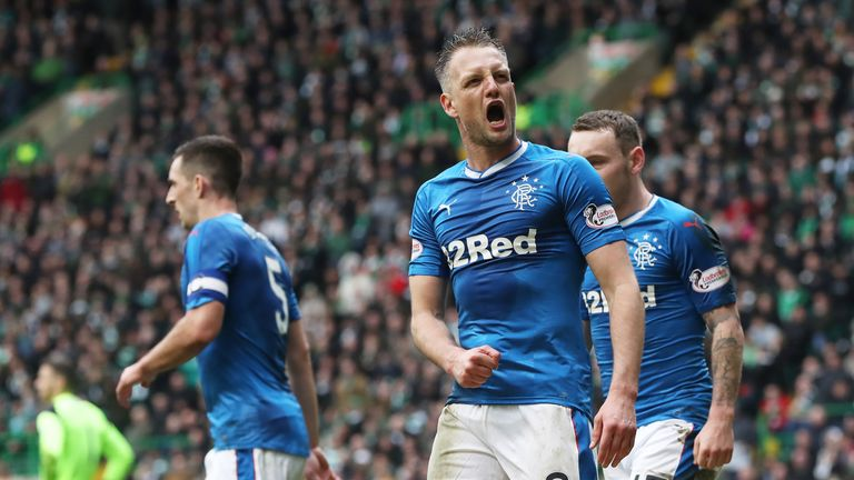Clint Hill celebrates his late equaliser against Celtic