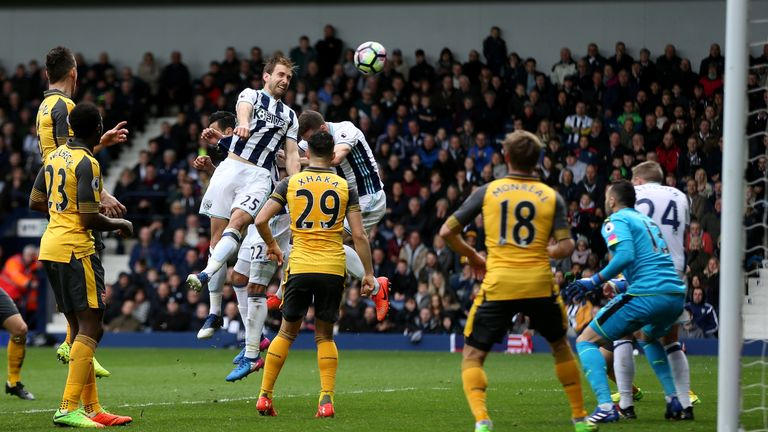 WEST BROMWICH, ENGLAND - MARCH 18: Craig Dawson of West Bromwich Albion (L) scores his sides third goal during the Premier League match between West Bromwi