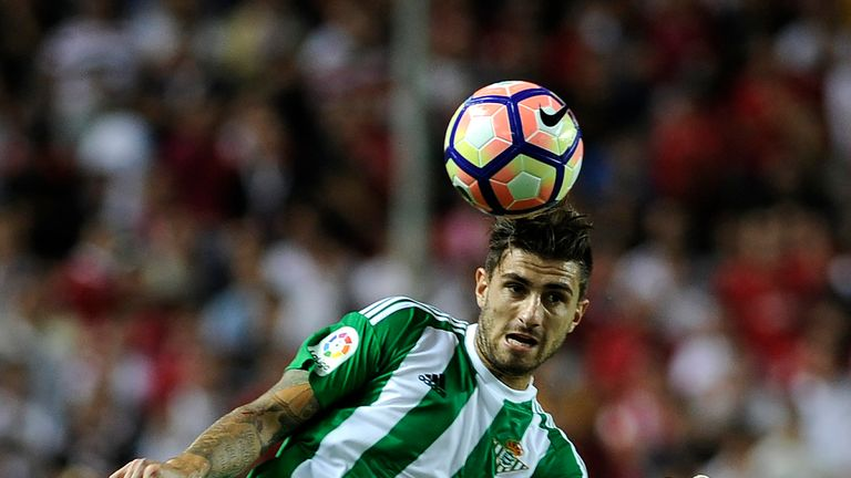 Betis' Italian forward Cristiano Piccini heads the ball during the Spanish league football match Sevilla FC vs Real Betis at the Ramon Sanchez Pizjuan stad