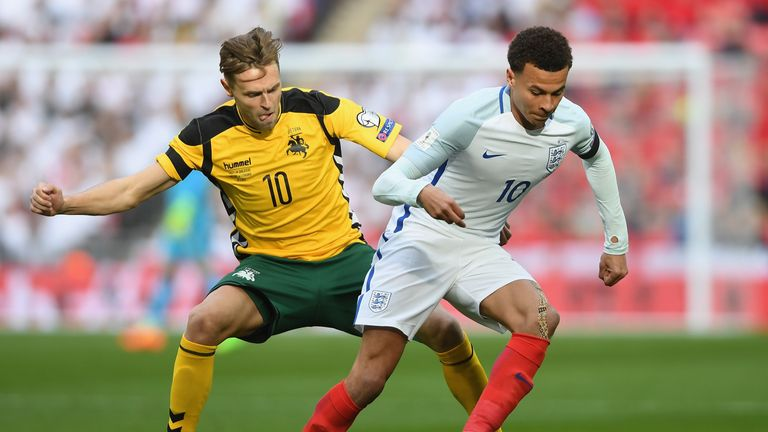 LONDON, ENGLAND - MARCH 26:  Dele Ali of England holds off Arturas Zulpa of Lithuania during the FIFA 2018 World Cup Qualifier between England and Lithuani