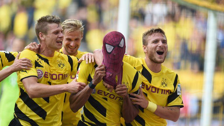 Dortmund's Italian striker Circo Immobile (R), Dortmund's Polish defender Lukasz Piszczek (L) celebrate after Dortmund's Gabonese striker Pierre-Emerick Au