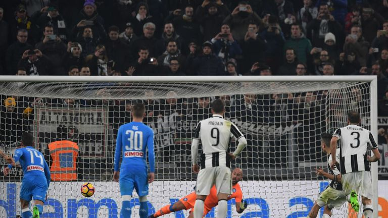Paulo Dybala scores his contentious second goal penalty from the spot