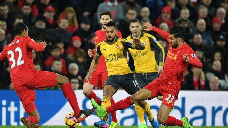 Emre Can (right) challenges Theo Walcott (centre) in the second half at Anfield