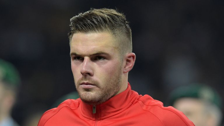 England's goalkeeper Jack Butland listens to the national anthem ahead the friendly football match Germany v England at the Olympic Stadium in Berlin on Ma