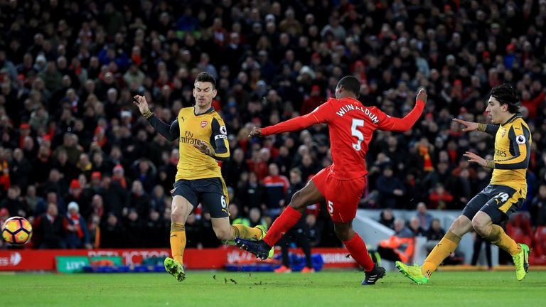 Liverpool's Georginio Wijnaldum scores his side's third goal of the game during the Premier League match at Anfield, Liverpool.