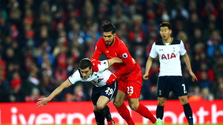 Harry Winks vies for the ball with Liverpool's Emre Can