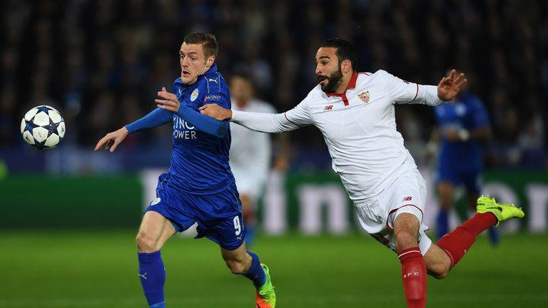Vardy sprints in behind Sevilla defender Adil Rami