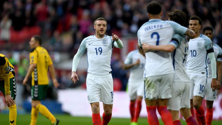 Jamie Vardy celebrates with his team-mates after scoring against Lithuania